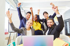 Young business people celebrating in start-up Stock Images