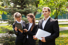 Young business people in a city park Royalty Free Stock Photo