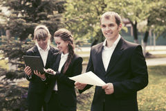 Young business people in a city park Stock Image