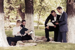 Young business people in a city park Royalty Free Stock Photography