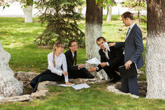 Young business people in a city park Stock Photography