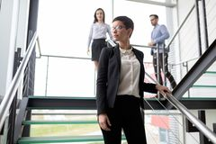 Young business people climb the stairs in the office royalty free stock photography