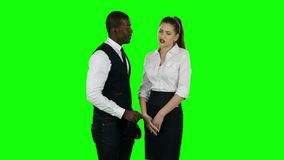 Young business people cooperate and shake hands. Green screen. Young business people cooperate and shake hands, serious working moments, a large number of stock video