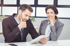 Young business people with digital tablet in office Royalty Free Stock Image