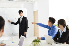Young business people discussing in  meeting Stock Photos