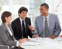 Young business people discussing a new strategy Royalty Free Stock Photos