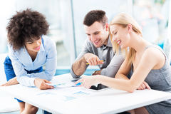 Young business people discussing in office Royalty Free Stock Images