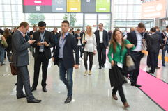 Young business people on german trade show Stock Photos