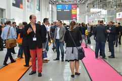 Young business people on german trade show Stock Image