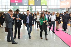 Young business people on german trade show Royalty Free Stock Photo