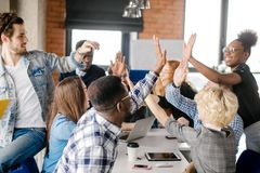 Young business people are giving five together to show their happiness royalty free stock photo