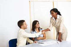 Young business people greetings Stock Photo