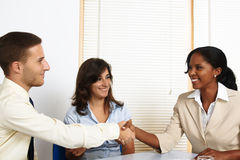 Young business people greetings Stock Images