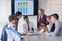 Young business people group on meeting at modern office Stock Photos