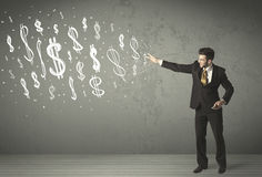 Young business people with hand drawn dollar signs Stock Images