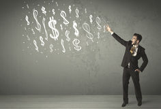 Young business people with hand drawn dollar signs Stock Photo