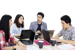 Young business people having a discussion on studio stock photos