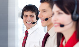Young business people with headsets on Stock Photo