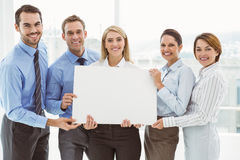 Young business people holding blank board in office Royalty Free Stock Photos