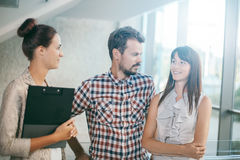 Young business people in informal chat Royalty Free Stock Photos