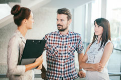 Young business people in informal chat Stock Photos