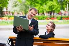 Young business people with laptop Stock Photo