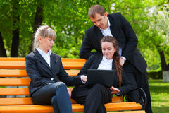 Young business people with laptop Royalty Free Stock Image