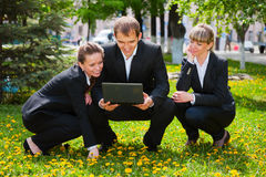 Young business people with laptop Stock Photos