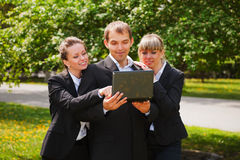 Young business people with laptop Royalty Free Stock Images