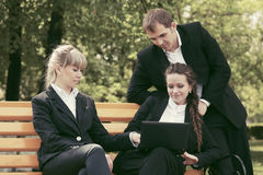 Young business people with laptop in city park Royalty Free Stock Images