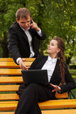 Young business people with laptop in a city park Royalty Free Stock Photo