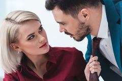 young business people looking at each other while businesswoman stock images