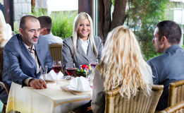Young business people at the lunch restaurant discussing Royalty Free Stock Image