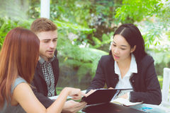Young business people making meeting and talking for analyzing marketing. Stock Photos