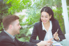 Young business people making meeting and talking for analyzing marketing. Royalty Free Stock Photography