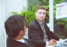 Young business people making meeting and talking for analyzing marketing. Royalty Free Stock Photos