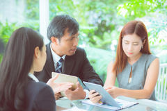 Young business people making meeting and talking for analyzing marketing. Stock Images