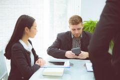 Young business people making meeting and talking for analyzing marketing. Royalty Free Stock Image