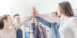 Young people joining hands together stock image