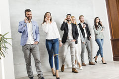 Young business people with mobile phones Stock Image