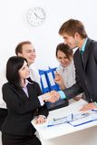 Young business people in office Royalty Free Stock Photos