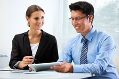 Young business people in an office stock images