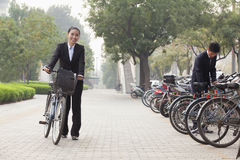 Young Business people parking their bikes in Beijing Royalty Free Stock Photography