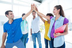 Young business people putting their hands together Royalty Free Stock Images