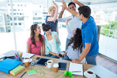 Young business people putting their hands together Stock Photography
