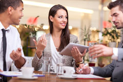 Young business people in the restaurant, coffee break Stock Photography