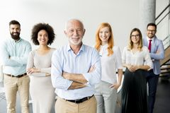 Young business people with senior colleague Royalty Free Stock Image