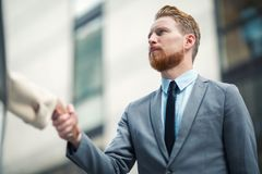 Business people shake hands in front of the office building Stock Photography