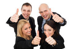 Young business people showing thumbs up Royalty Free Stock Photos