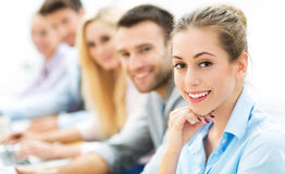 Young business people sitting in a row Royalty Free Stock Photo